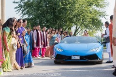 Guests observe the nice ride coming to the ceremony