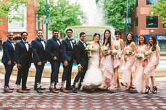 Groomsmen and bridesmaids posing with the Indian couple