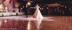 Indian bride and groom glowing in the dance floor