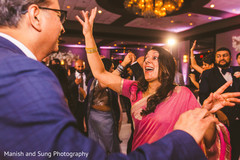 Joyful Indian guests dancing at the reception
