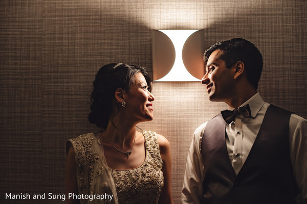 Indian newlyweds looking at each other during the photo shoot