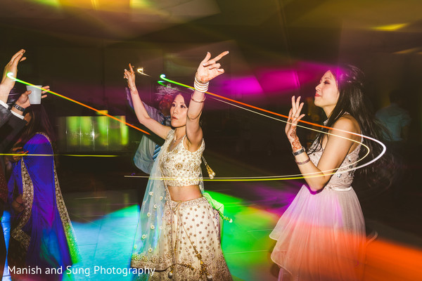 Indian bride and guests having a blast during the party