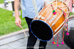 Capture of the dhol player outdoors during baraat
