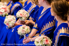 Indian bridesmaids holding the beautiful bouquets