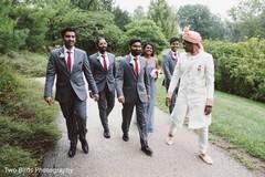 Indian groom, groomsmen and bridesmaid outdoors