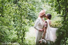 Indian bride and groom kissing outdoors