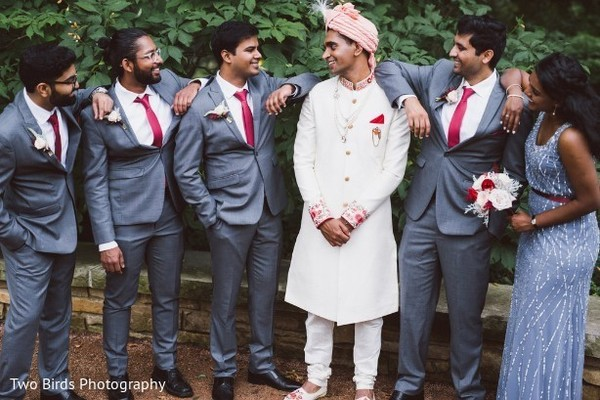 Indian groom, groomsmen and bridesmaid during pictures