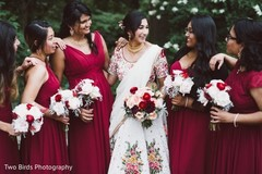 Maharani posing for pictures with bridesmaids