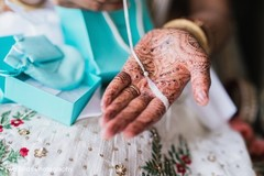 Details of bridal jewelry and mehndi