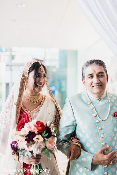 Indian bride and her father at the beginning of the ceremony