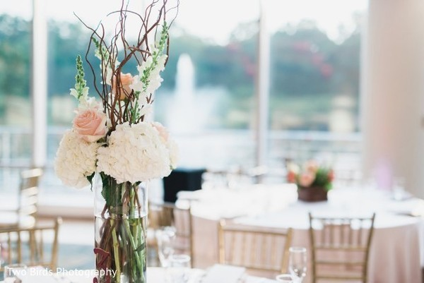 Detail of a floral center piece at the reception venue