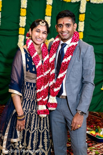 Joyful Indian newlyweds posing for pictures