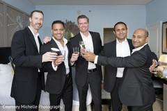 Happy Indian groom celebrating with groomsmen.