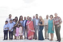 Maharani and raja posing with family.