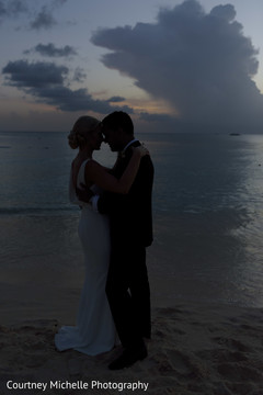 By the beach Indian bride and groom silhouette photo.