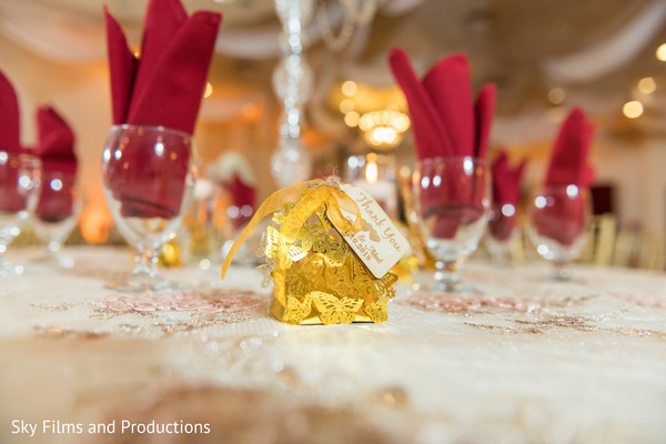 Dreamy Indian wedding reception table favors and decoration.