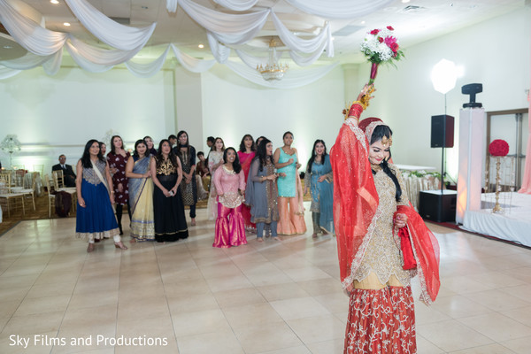 Lovely indian bridal about to throw her bouquet.
