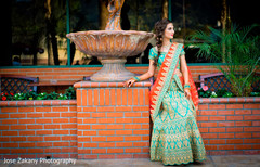 Stunning Indian bride posing for pictures outdoors