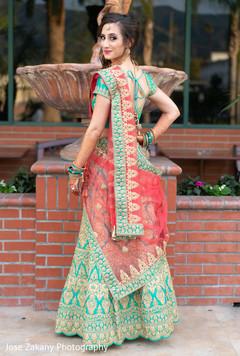 Beautiful maharani wearing a beautiful green lengha