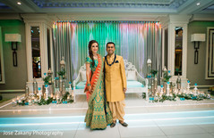 Indian bride and groom posing at the venue