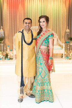 Elegant capture of Indian bride and groom at the venue