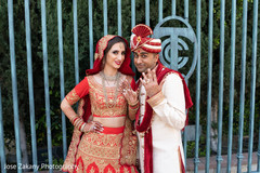 Indian bride and groom exited by showing their wedding rings.