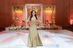 Adorable indian bride with her wedding reception outfit.