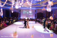 Glamorous indian bride and groom dancing photography.