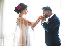 Ravishing Indian couple's wedding reception attire.
