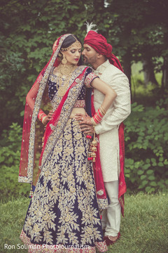 Lovely Indian couple in their ceremony outfits.