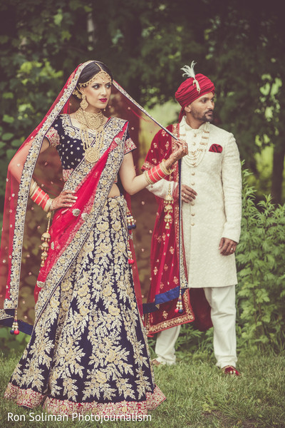 Adorable Indian bride and groom outdoor portrait.