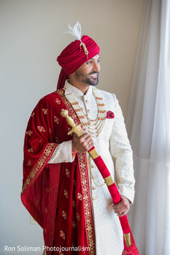 Gorgeous Indian groom in his traditional ceremony outfit.