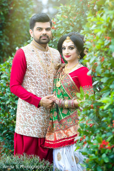 Lovely Indian couple on their ceremony outfits.