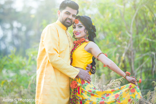 Indian bride and groom ready for their haldi party.
