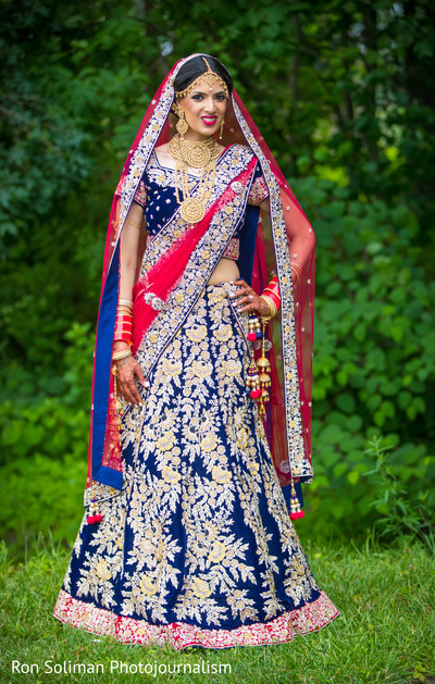 Lovely Indian bride posing outdoors.