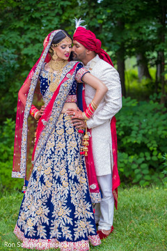 Enchanting Indian bride and groom outdoors capture.