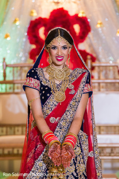 Sweet Indian bride posing on her ceremony outfit.