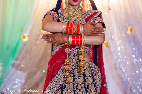 Indian bride showing mehndi art.