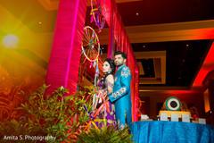 Lovely Indian wedding couple posing at sangeet.