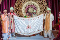 Maharaja being covered with antarpat at ceremony.