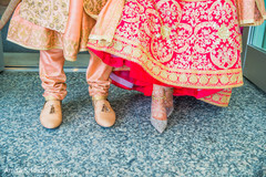 Indian bride and groom's wedding ceremony shoes capture.