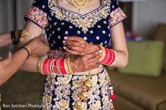 Indian bride putting bangles capture.