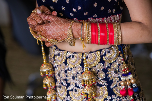Stunning Indian bridal mehndi art and jewelry capture.