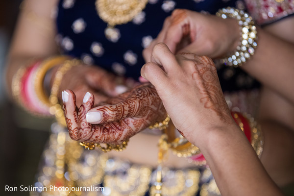 Indian bride getting her bangles on capture.