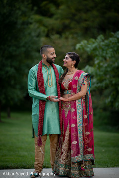 Indian bride and groom's sangeet photo session.