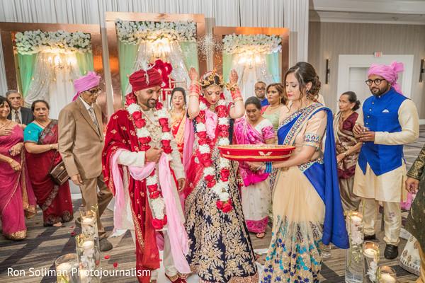Indian bride and grooms during Sindoor wedding ritual.