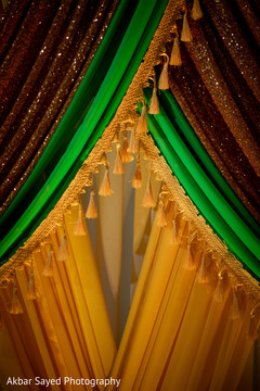 Colorful draping sangeet mandap closeup.