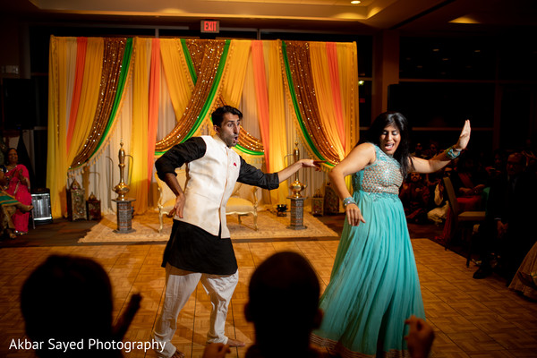 Gleeful indian sangeet dance performance.