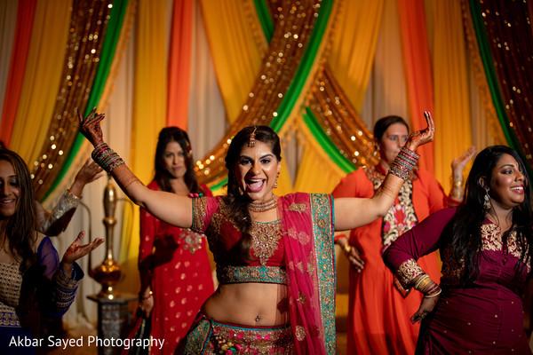 Maharani with bridesmaids at a sangeet dance.