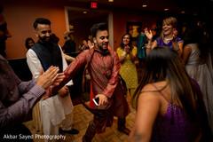 Jubilant indian pre-wedding guests.